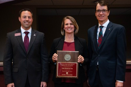 From left: Matt vandenBerg, vice president for advancement; Dr. Lisa Knowles; Jeff Abernathy, Alma College president.