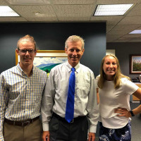 Emily Esser '19 and Adam Cousineau '19 interned with Doug Gross '77 at Raymond James