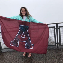 Ellen Laurenz with the Alma Flag.
