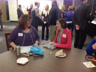Alumna Erika Powers-Appelt and ChelseaRae Rowley at the 2014 Chicago In-City Program networking reception