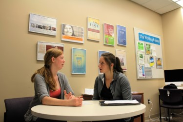 Two students talking at the Writing Center.