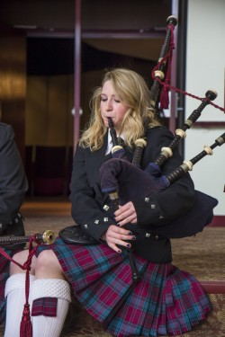 Student playing the bag pipes.