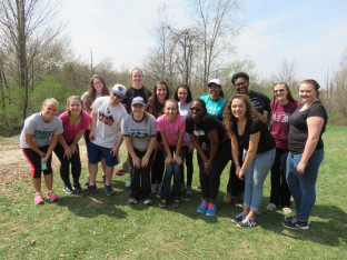 Mentors participate in team bonding activities during spring training at Camp Henry