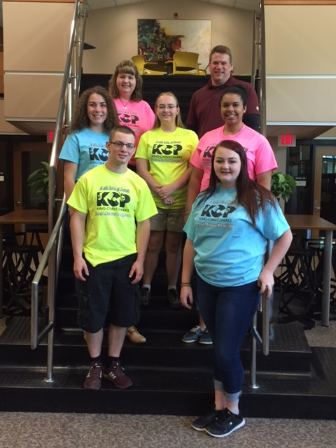 "KCP Program mentors pose for a picture in their new ""Ask me about KCP"" T-Shirts for Becoming A Scot Day"