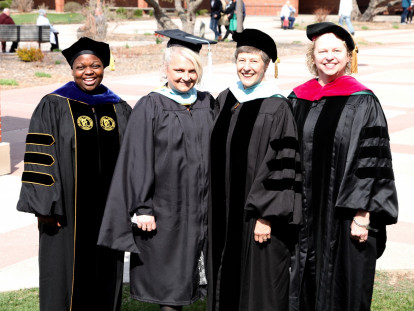 Education Faculty pose for a photo after Commencement.