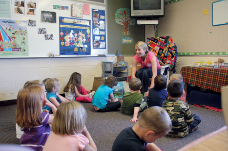 An Alma student engages young students during her elementary education student teaching experience.