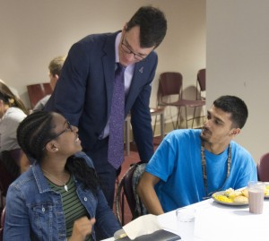 Alma College President Jeff Abernathy with students in Hamilton Commons