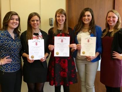 New and continuing Lambda Pi Eta members