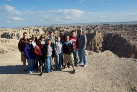 Performing Advocacy students in the South Dakota Badlands with Dr. Joanne Gilbert