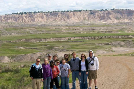 Performing Advocacy student in the South Dakota Badlands during their spring term class with Dr. Joanne Gilbert