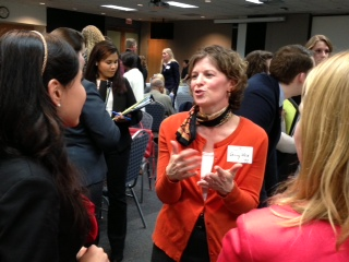 Sally Weir '90 talks with students at the Chicago In-city Interview reception.