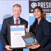 Sandy Hulme presents a certificate of recognition to a Model UN participant at the 2014 Presidium conference in New Delhi.
