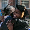 Faculty congratulate new graduates.