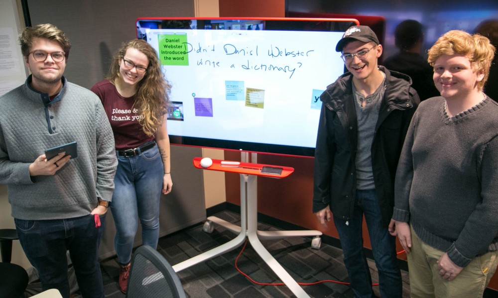 Alma College students interact with the Jamboard.