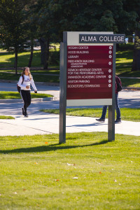 A student walks by the directory sign outside Reid Knox hall.