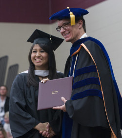Student Alma Leon receiving her degree at the Commencement ceremony.