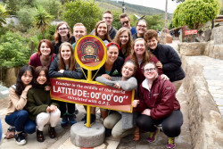 Professor Joanne Gilbert and Alma College students visit the equator during their Spring Term class in Ecuador.