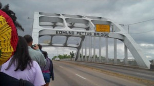 "Student Freedom Riders cross the historic Edmund Pettus Bridge, site of ""Bloody Sunday"" in 1965 when civil rights activists were attacked by police and dogs while marching from Selma to Montgomery for voting rights."