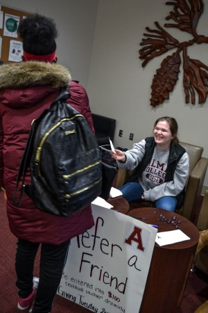 "Members of SAA host the ""refer a friend"" table in Hamilton Commons."