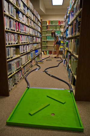 Popular activity: Miniature golf in the library.