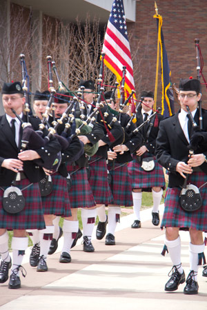 The pipers begin the procession.