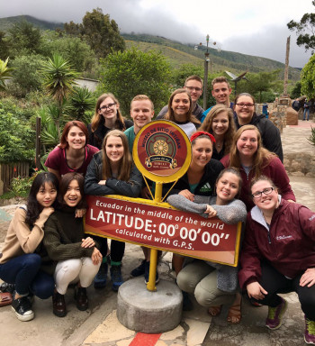 Alma students at the Equator.