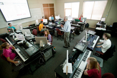 Ray Riley, standing in center, teaches in the music lab.