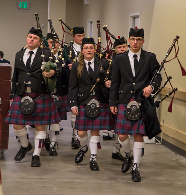 The pipers prepare backstage for the concert.