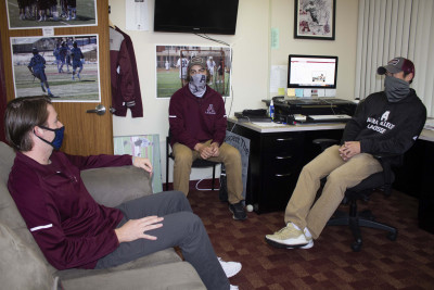 Pictured from left are Alma College junior Timothy Gearig, lacrosse assistant coach Jared Nycz an...