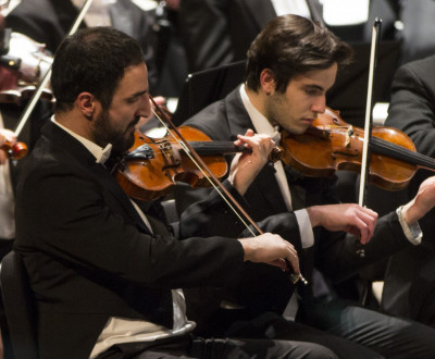 <em>Members of the Alma Symphony Orchestra.</em>