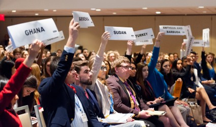 Model UN delegates vote on a resolution.
