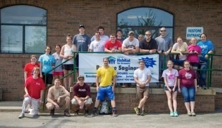 Students assist Habitat for Humanity.