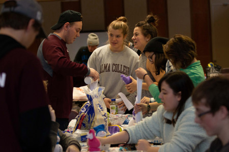 Alma College and Alma High School students make holiday crafts for the residents of a local assisted living facility.