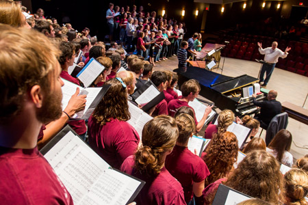 The alumni choir rehearses with Will Nichols.