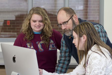 <em>Dave Clark, with students, in the Dow Digital Science Center.</em>