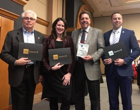 From left: Alumni Bill Moss, Emalee Rose, Bill McHenry II and Matt vandenBerg receive the Pride of CASE V awards.