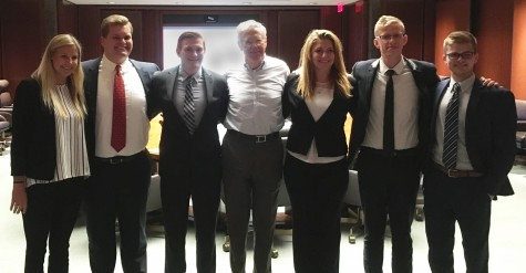 <em>Dylan Scott, second from right, with fellow interns and company CEO Charles Koch, center.</em>