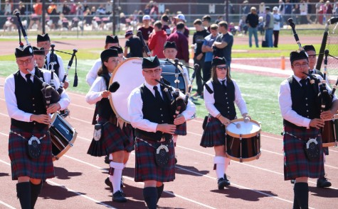<em>The Pipe Band performs at homecoming.</em>