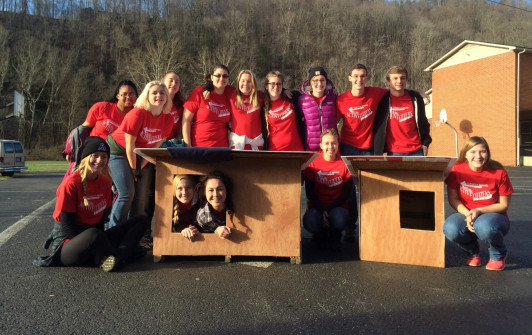 <em>Alma students build dog houses during a recent animal welfare alternative break.</em>
