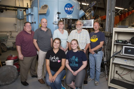 <em>Melissa Strait (back row, center) with Alma students Emma Patmore '15 and Angie Clayton '14 (front row) and researchers at the NASA Ames Vertical Gun Range in California (2013).</em>