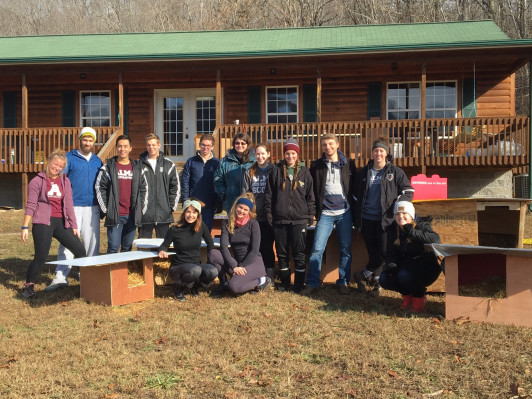 <em>Students built doghouses and provided education about care for dogs in a rural setting during an Alternative Break trip to Kentucky.</em>