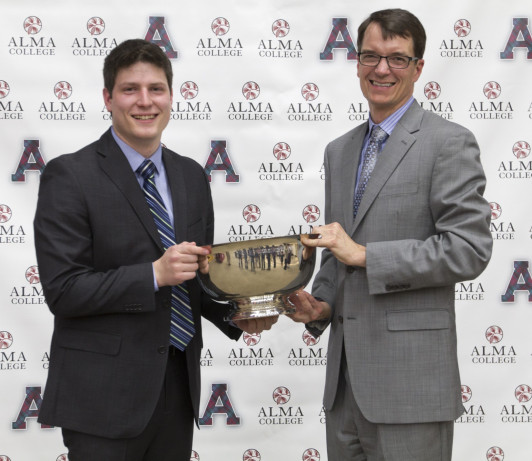 President Jeff Abernathy (right) presents the Barlow Trophy to Michael Reeves.