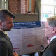 James Budrick-Diaz, Laura Smith present their research poster.