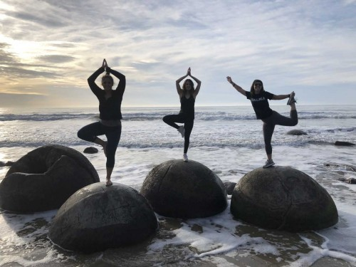 spring term class, students yoga on rocks