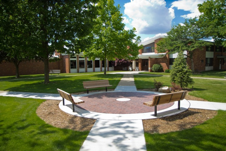Benches on campus in front of Gelston Hall.