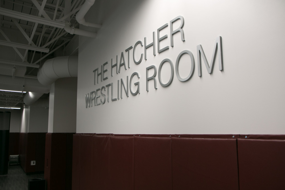 Sign reading Hatcher Wrestling Room.