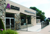 Exterior shot of front entrance of Alma College bookstore and Starbucks