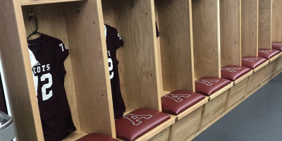 Wooden lockers in the football/lacrosse locker room.