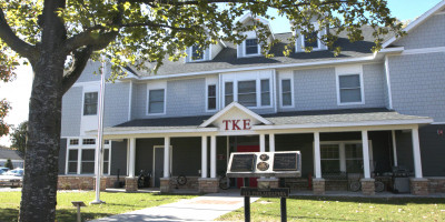 Exterior shot of TKE house on Alma College's Campus