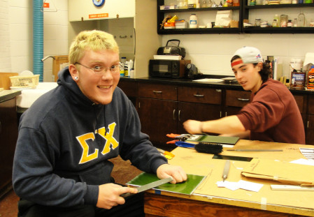 Students Marshall and Jerry in printmaking studio.
